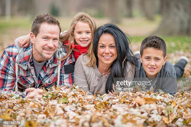 Family Lying in a Pile of Leaves