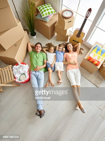 Family lying on floor and smiling