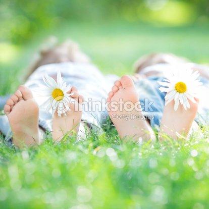 Family lying on grass : Stock Photo