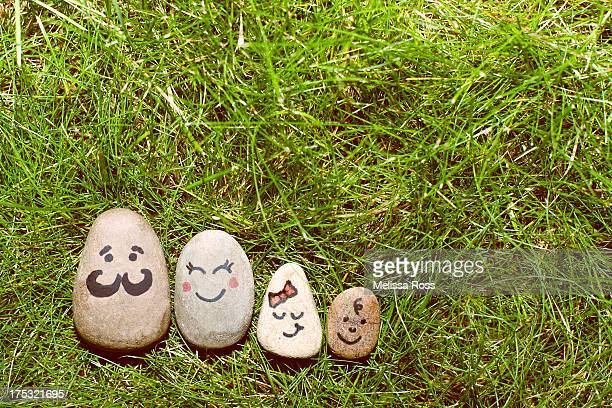 Family made from rocks or stones.