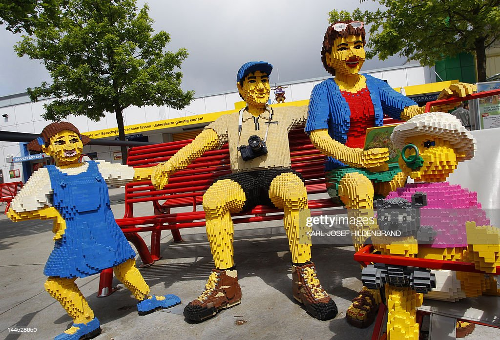 A family made of Lego bricks sit on a bench at the Legoland themepark in Guenzburg, southern Germany, on May 15, 2012. The park will celebrate its 10th anniversary on May 17, 2012.