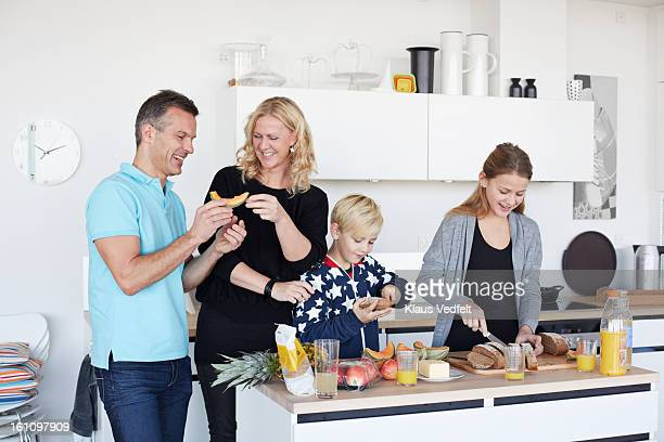 Family making healthy breakfast together