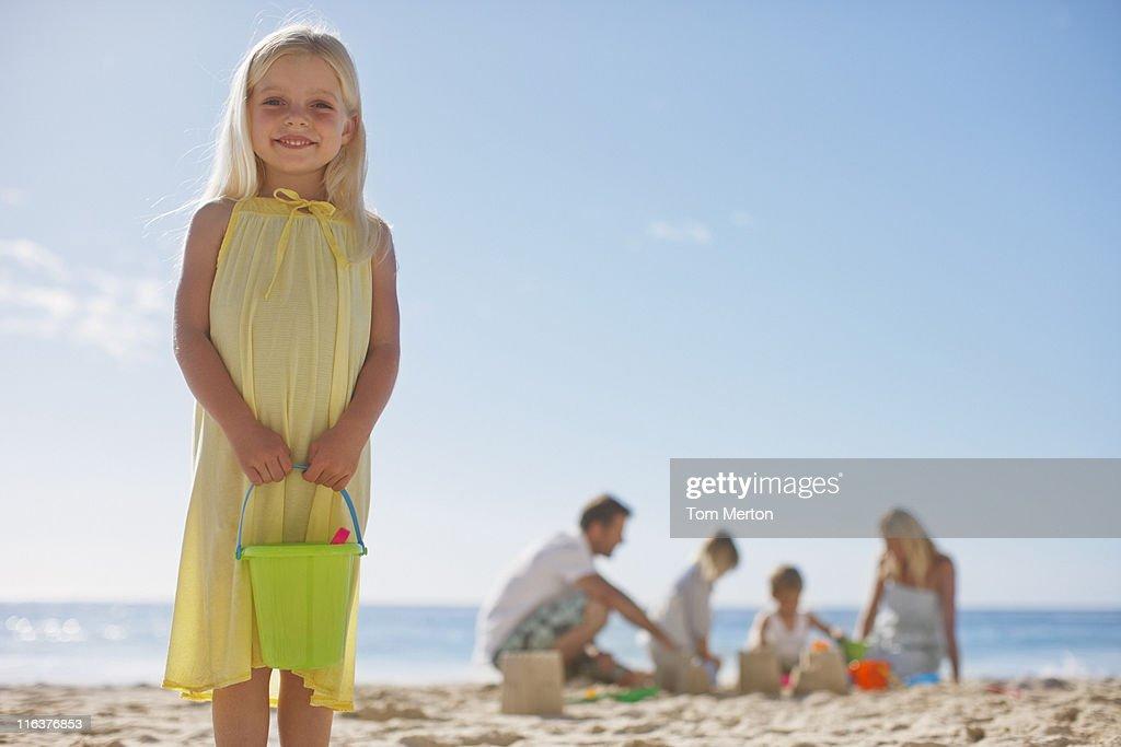 Family making sand castles on beach : Stock Photo