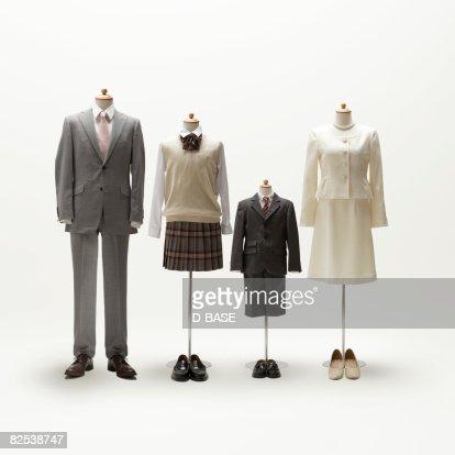 Family mannequin dressing formal wear.