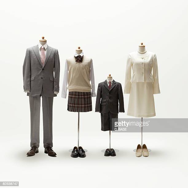 Family mannequin dressing formal wear.