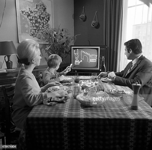 Family meal around the television