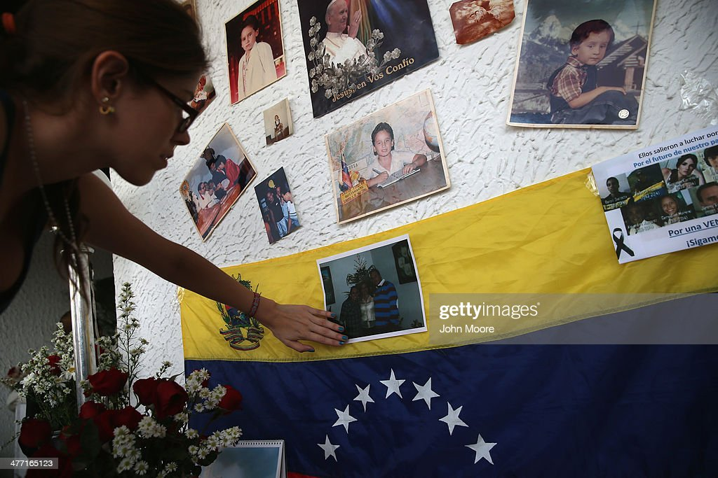 A family member attends the last day of mourning for Jimmy Vargas, 34, on March 7, 2014 in San Cristobal, Venezuela. Vargas died in a clash between students and the Venezuelan national guard on February 24 during an anti-government protest.