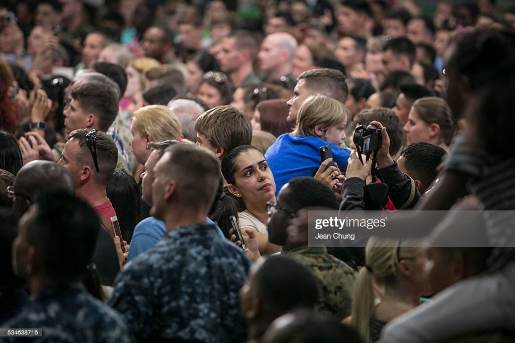 A family member of a U.S. serviceman takes a snapshot of herself and possibly U.S. President Barack Obama (not shown) in her background during the speech at the Marine Corps Air Station Iwakuni (MCAS Iwakuni) on May 27, 2016 in Iwakuni, Japan. President Barack Obama flew in to the MCAS Iwakuni on Air Force One, and visited the troops before visiting Hiroshima.