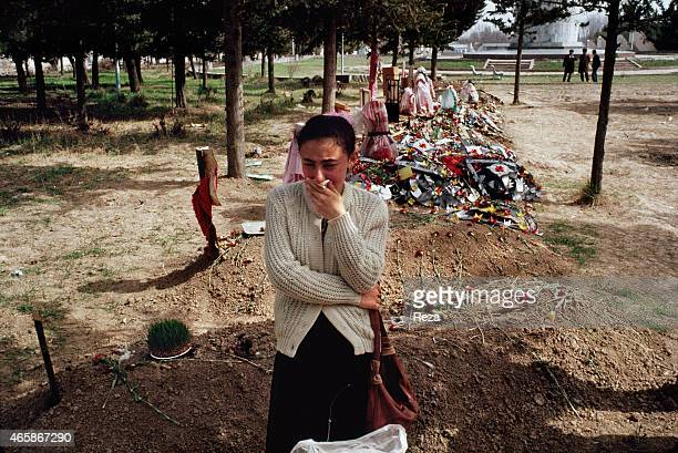 A family member of a victim of a mass killing in Khojaly Azerbaijan mourns her relative in a makeshift cemetery in Aghdam Azerbaijan in February 1992...