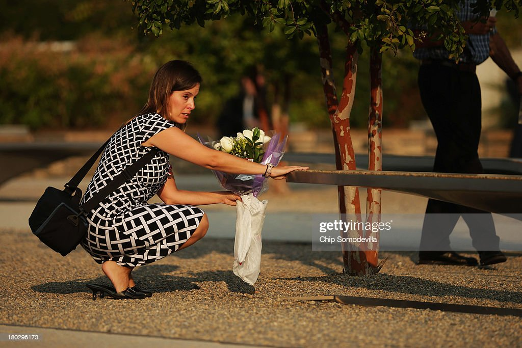 A family member of the victims of the September 11, 2001 attack on the Pentagon visits the memorial site before an observance ceremony at the Pentagon September 11, 2013 in Arlington, Virginia. Family members of victims and survivors of the attack gathered to hear from President Barack Obama and other leaders at the National 9/11 Pentagon Memorial near the place where terrorists drove a jetliner into the Department of Defense headquarters in 2001.
