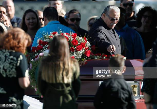 A family member places a flower on the casket of Heather Lorraine Alvarado on October 13 2017 in Enoch Utah Alvarado was a 35 year old wife and...