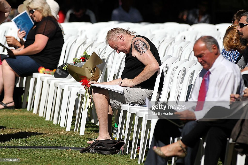 A family member reflects at the start of a Civic Memorial Service held in the Botanical Gardens for victims of the 2011 Christchurch Earthquakes on February 22, 2014 in Christchurch, New Zealand. The earthquake measuring 6.3 in magnistude devastated Christchurch killing 185 people and causing an estimated $40 billion in damage to the city's buildings and infrastructure.