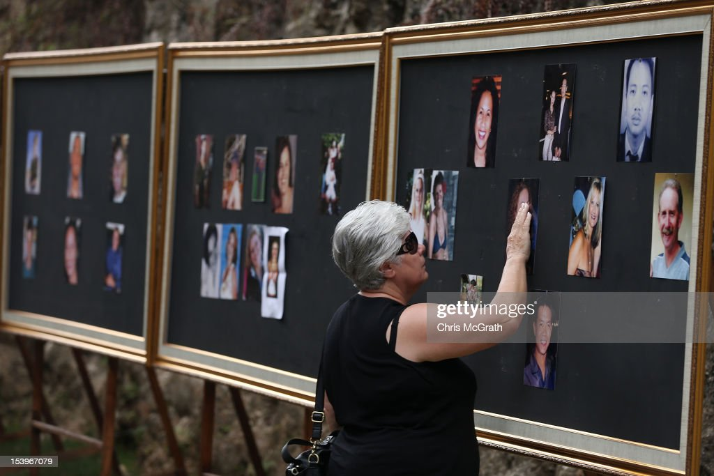 A family member touches a photograph on the photo wall after the Bali Bombing 10th anniversary ceremony held at Garuda Wisnu Kencana on October 12, 2012 in Jimbaran, Bali Indonesia. Hundreds of family members, friends and general public gathered to remember the victims of the 2002 Kuta nightclub bombings which killed 202 people, including 88 Australians.