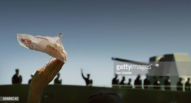 A family member waves goodbye as the HMAS Parramatta departs for the Persian Gulf on October 10 2005 in Sydney Australia The Anzac Class Frigate will...