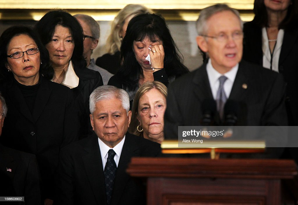 A family member wipes her tears as U.S. Senate Majority Leader Sen. Harry Reid (D-NV) speaks as Senator Daniel Inouye (D-HI) lies in state in the Rotunda of the U.S. Capitol during a service December 20, 2012 on Capitol Hill in Washington, DC. The late Senator had died at the age of 88 on Monday at the Walter Reed National Military Medical Center in Bethesda, Maryland where he had been hospitalized since early December. A public funeral service will be held at the Washington National Cathedral on Friday for Senator Inouye, a World War II veteran and the second-longest serving senator in history. His remains will be returned and laid to rest in his home state.