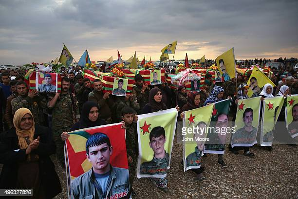 Family members and comrades march in a funeral procession for of eight members of the People's Protection Units on November 8 2015 in Derek Rojava...