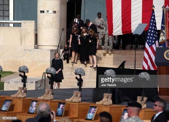 Family members and friends arrive for the start of the memorial service that US President Barack Obama and first lady Michelle Obama will attend for...