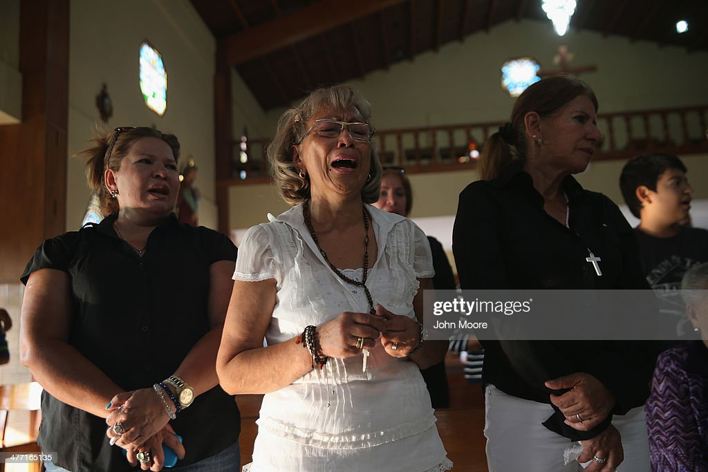 Family members and friends attend a mass for anti-government protester Jimmy Vargas, 34, on March 7, 2014 in San Cristobal, Venezuela. Vargas died in a clash between students and the Venezuelan national guard on February 24 during an anti-government protest.