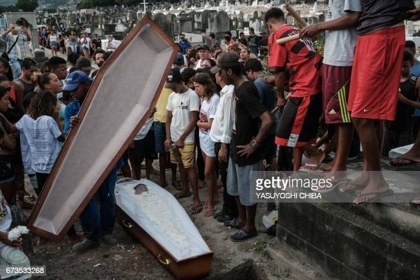 TOPSHOT Family members and friends attend the funeral of 13yearold Paulo Henrique de Oliveira who was killed by a stray bullet during a police...