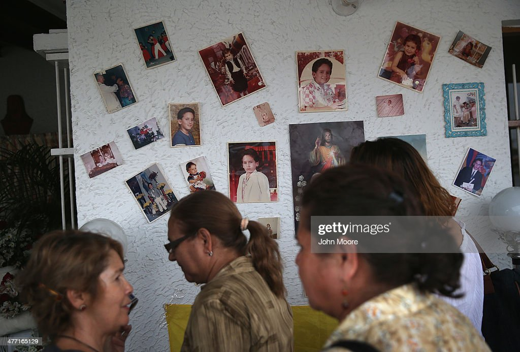 Family members and friends attend the last day of mourning for Jimmy Vargas, 34, on March 7, 2014 in San Cristobal, Venezuela. Vargas died in a clash between students and the Venezuelan national guard on February 24 during an anti-government protest.