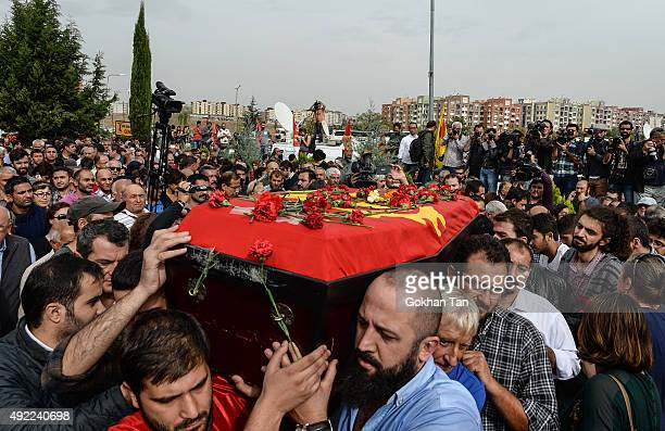 Family members and friends carry the coffin of Korkmaz Tedik a victim of Saturday's bomb blasts during a funeral ceremony in Ankara October 11 2015...