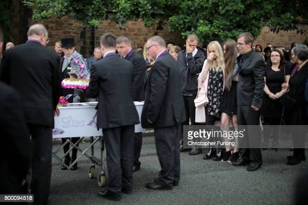 Family members and friends follow the funeral cortege of Manchester attack victim Lisa Lees as her coffin arrives at St Anne's Church on June 23 2017...