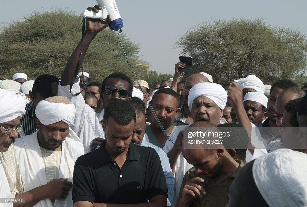 Family members and friends gather for the funeral of Salah Mudathir killed the day before in clashes following protests in the Sudanese capital...