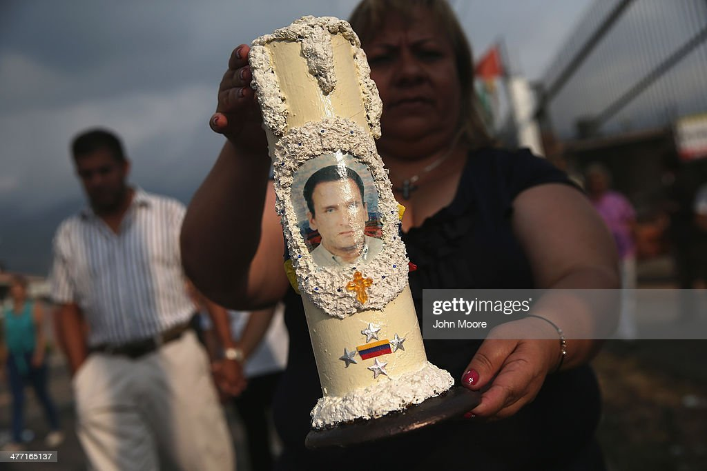 Family members and friends leave a church following a mass for anti-government protester Jimmy Vargas, 34, on March 7, 2014 in San Cristobal, Venezuela. Vargas died in a clash between students and the Venezuelan national guard on February 24 during an anti-government protest.