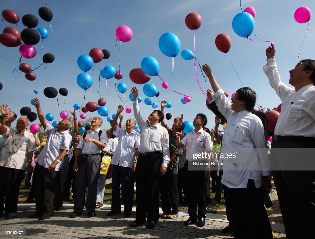 Family members and friends release colourful balloons as a symbol of peace during the World War II Japanese Invasion Day Commemoration Ceremony on September 1, 2013 in Nilai, Malaysia. Many Malaysians still remember the atrocities inflicted by the Japanese army in Malaysia from September 1, 1941 for three years and eight months during World War II.