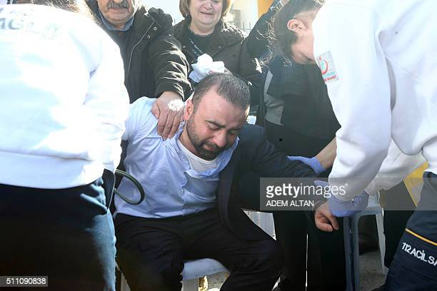 Family members and relatives mourn outside a morgue in Ankara on February 18 a day after a car bombing targeted military vehicles killing 28 At least...