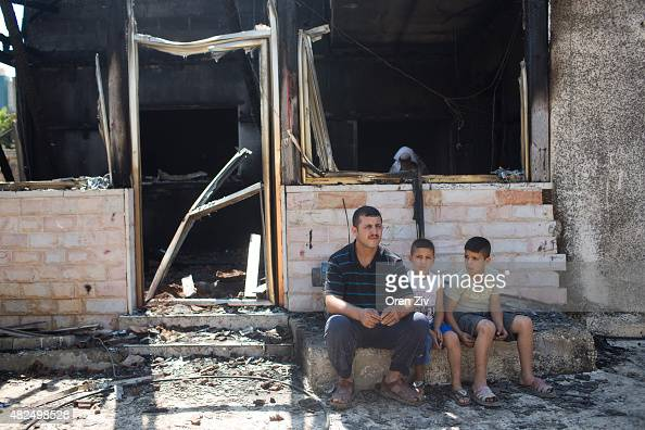 Family members and relatives of 18 month old baby Ali SaadDawabsheh view the remains of their house after a fire which was suspected to have been set...