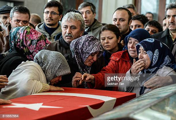 Family members and relatives of car bombing victim Murat Gul mourn over a coffin during the funeral ceremony in a mosque on March 14 2016 in Ankara...