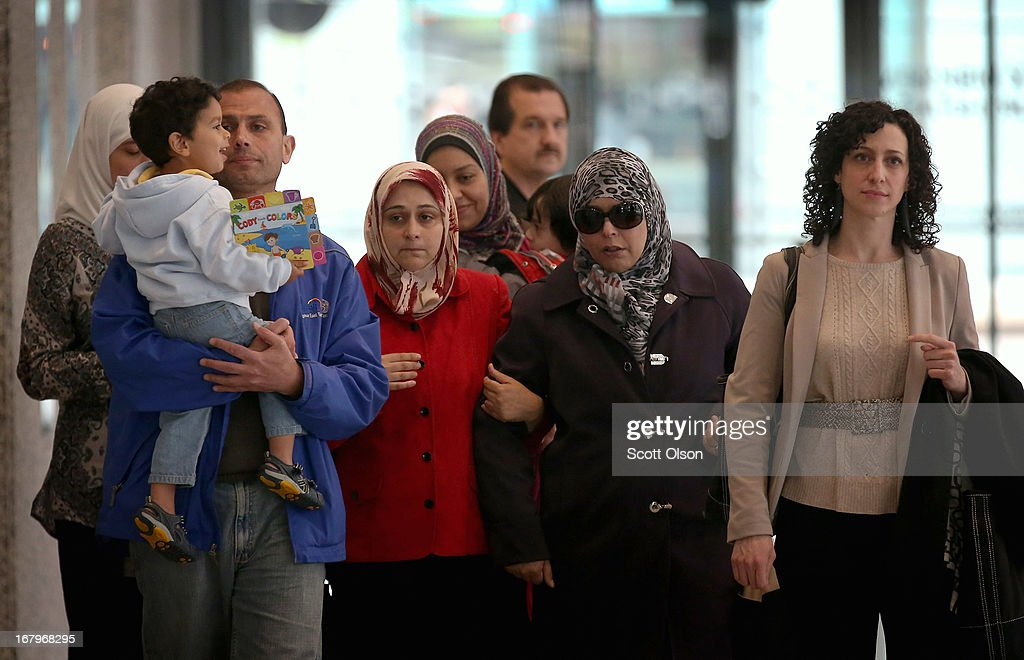 Family members and supporters of 18-year-old Abdella Ahmad Tounisi, including his mother Seham (2nd from Right) and attorney Molly Armour (R), leave the Dirksen Federal Building following a court hearing for Tounisi on May 3, 2013 in Chicago, Illinois. A judge today overturned yesterday's decision by Judge Daniel Martin to release Tounisi on bond. Tounisi is accused of trying to fly to Turkey to join up with an al-Qaida group to fight in Syria. He has also been accused of plotting to bomb a Chicago bar last year.