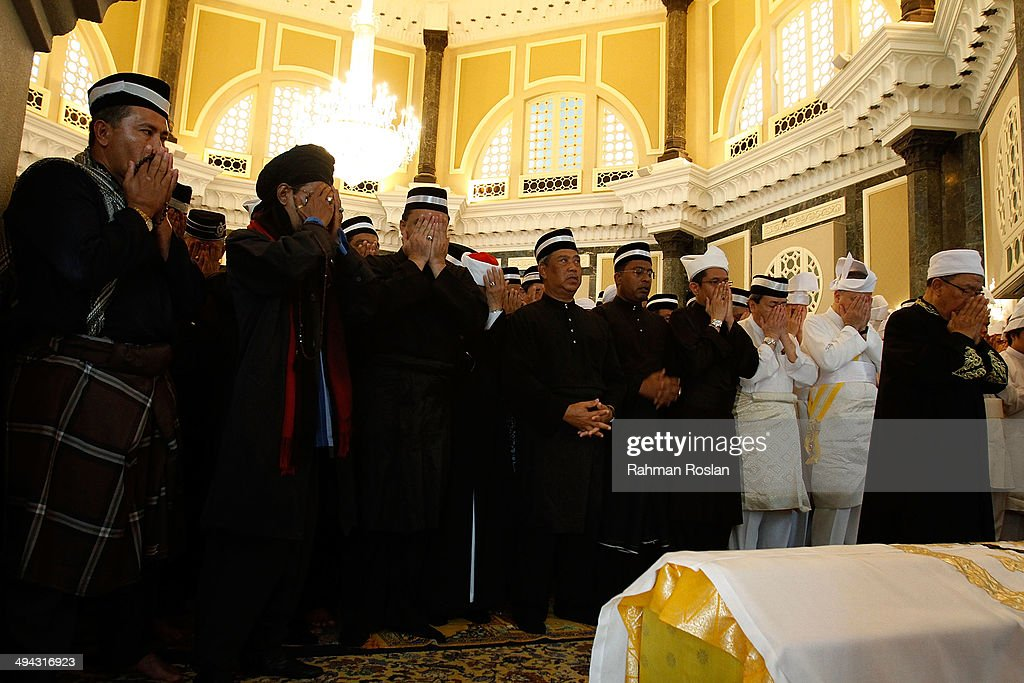 Family members and the public perform a special prayer during Sultan Azlan Shah's royal burial ceremony on May 29 2014 in Kuala Kangsar Perak...
