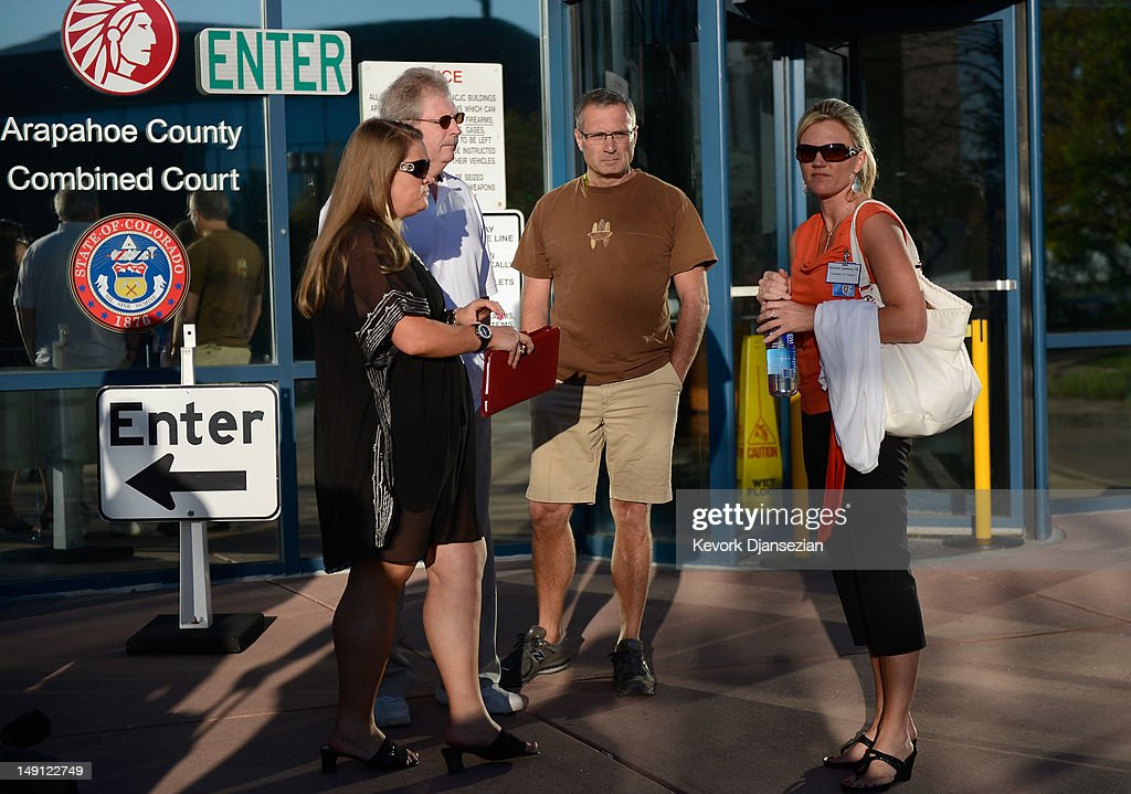 Family members (second left and second right) and their representatives wait to enter the Arapahoe County Courthouse for the first court hearing for alleged Century 16 movie theater shooter on July 23, 2012 in Centennial, Colorado. James Holmes, 24, allegedly went on a shooting spree and killed 12 people and injured 58 during an early morning screening of 'The Dark Knight Rises.'