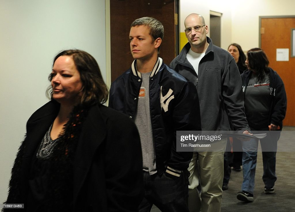 Family members and victims enter the second floor of the Arapahoe County Courthouse, Friday, January 11, 2013 on their way to the courtroom. The arraignment for Aurora theater shooting suspect James Holmes was postponed until March 2013 for the July 20 shooting at the Century 16 theater that killed 12 people and injured 70 others.