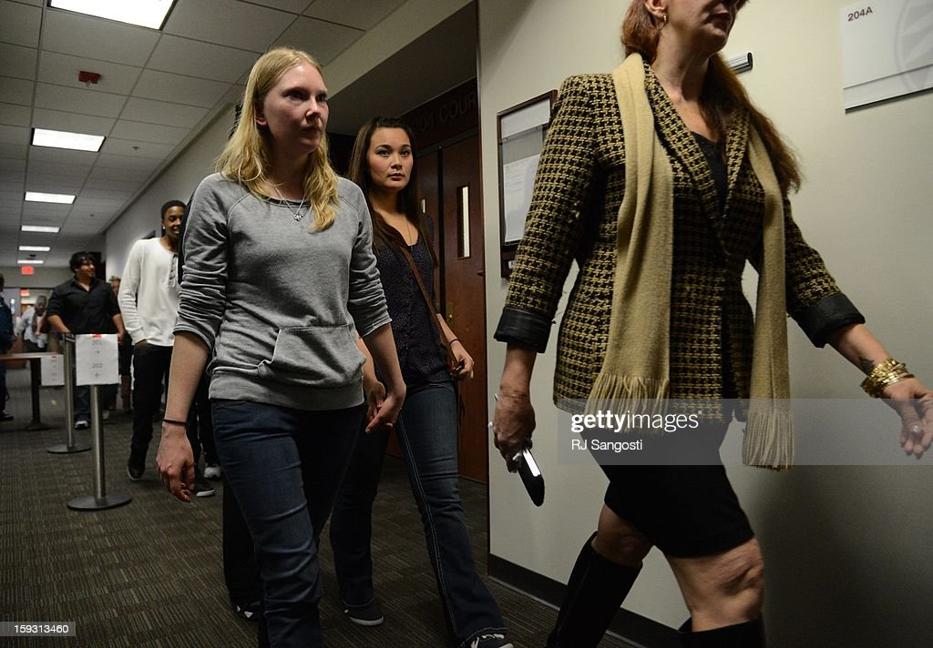 Family members and victims leave the courtroom, in the Arapahoe County Courthouse, Friday, January 11, 2013. The arraignment for Aurora theater shooting suspect James Holmes was postponed until March 2013 for the July 20 shooting at the Century 16 theater that killed 12 people and injured 70 others.