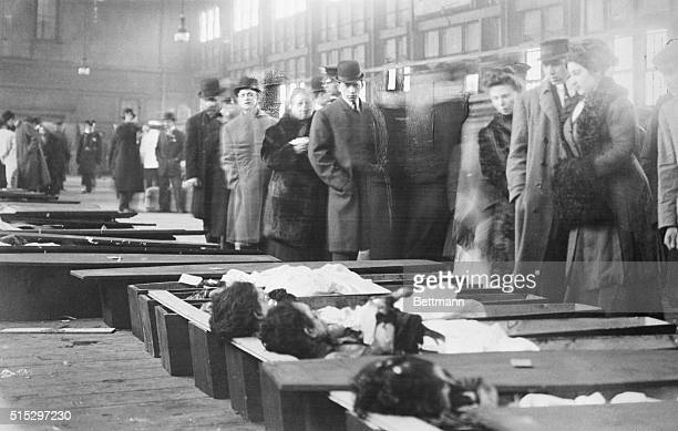 Family members arrive at the New York City morgue to identify the bodies of victims of the Triangle Shirtwaist Company Fire that killed 146 factory...