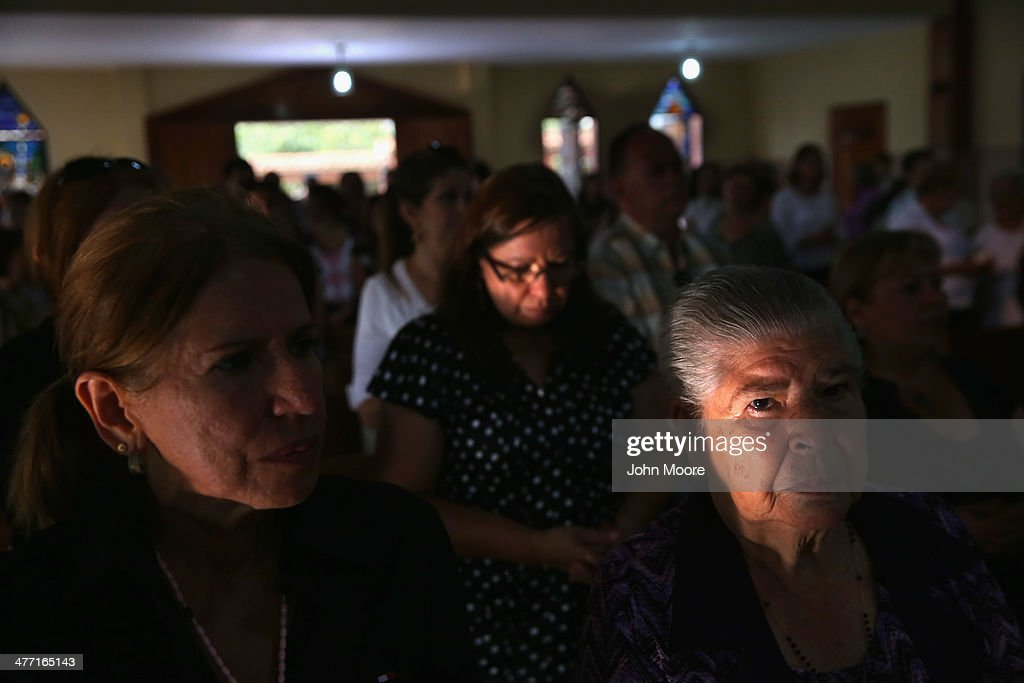 Family members attend a mass for Jimmy Vargas on March 7, 2014 in San Cristobal, Venezuela. Vargas died in a clash between students and the Venezuelan national guard on February 24 during an anti-government protest.