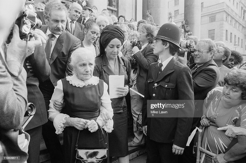 Family members attend a memorial service for Welsh actor Richard Burton at St-Martin-in-the-Fields Church, London, 30th August 1984. Burton's ex-wife <a gi-track='captionPersonalityLinkClicked' href=/galleries/search?phrase=Elizabeth+Taylor&family=editorial&specificpeople=69995 ng-click='$event.stopPropagation()'>Elizabeth Taylor</a> leaves the church, with his elderly sister.