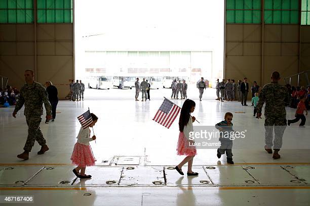 Family members await the arrival of soldiers from the US Army's 101st Airborne Division during a homecoming ceremony at Campbell Army Airfield on...