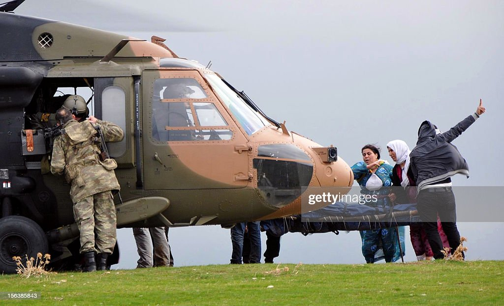 Family members carry the body of a PKK (Kurdistan Workers Party) rebel to a Turkish army helicopter after clashes near Sirnak on November 14, 2012. Turkey's government submitted a bill to parliament yesterday to give Kurds the right to use their own language in court, a key demand of hundreds of prisoners who have been on hunger strike for two months. STR