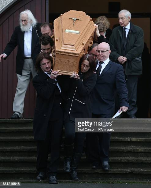 Family members carry the coffin at the funeral of Therese MacGowan the mother of singer Shane MacGowan at Our Lady of Lourdes Church Silvermines Co...