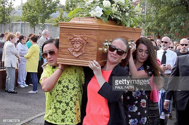 Family members carry the coffin of Gerry Conlon from his home in west Belfast on June 28 2014 Conlon who wrongly spent 15 years in jail over a 1974...