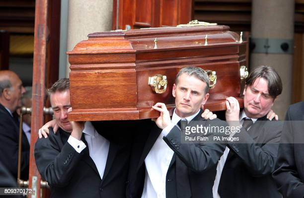 Family members carry the coffin of Sir Oliver Napier after his funeral mass at St Colmcille's Church Holywood Co Down