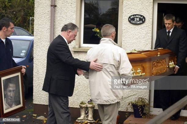 Family members carry the remains of Jean McConville into her son Michael McConville house at Crumlin Co Antrim Mrs McConville was abducted and...