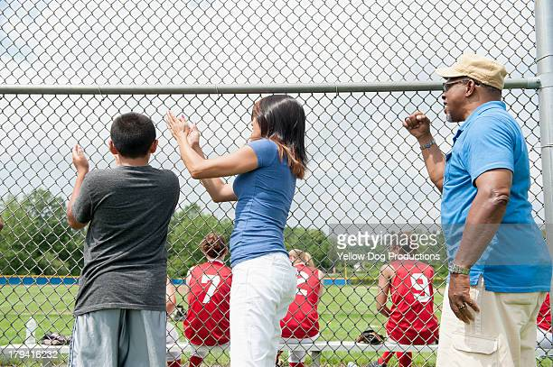 Family Members Cheering  Players on Sidelines