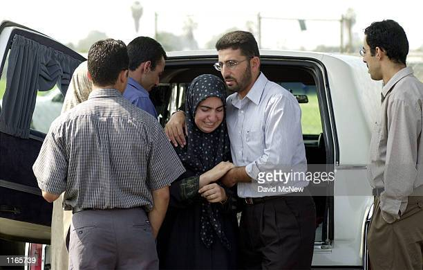 Family members comfort each other during funeral services for Abdullah Mohammed Nimer at the Islamic Society of Orange County October 10 2001 in...