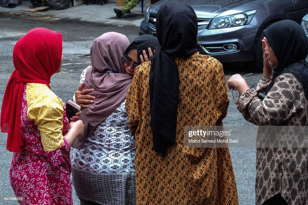 Family members console each other at Kuala Lumpur Hospital after a fire broke out yesterday at the religious school Darul Quran Ittifaqiyah on September 15, 2017 in Kuala Lumpur, Malaysia. A fire at the religious school in the Malaysian capital killed almost two dozen people including 21 students and two teachers.