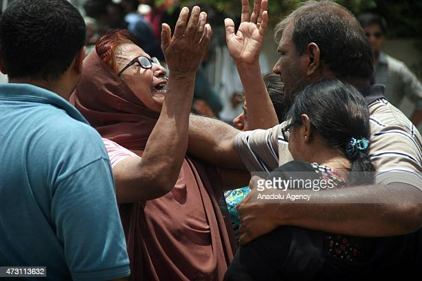 Family members console each other outside a hospital following a gun attack on a bus carrying members of Ismaili Shia community outside a a local...